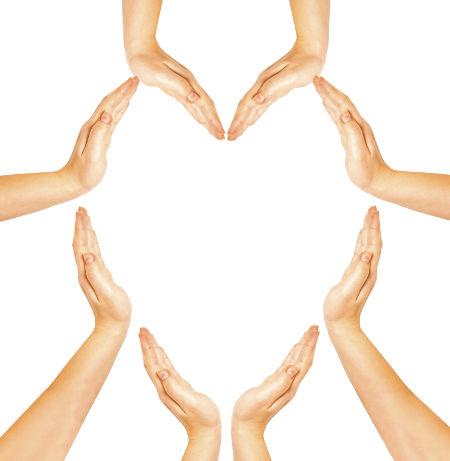 woman's hands make heart shape